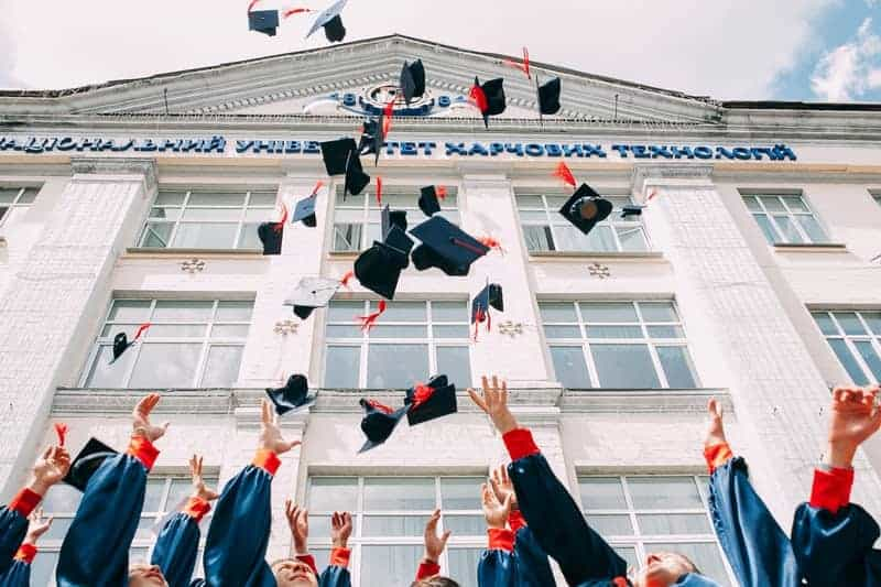 Visual of graduates throwing their hats in the air rotary scholarships